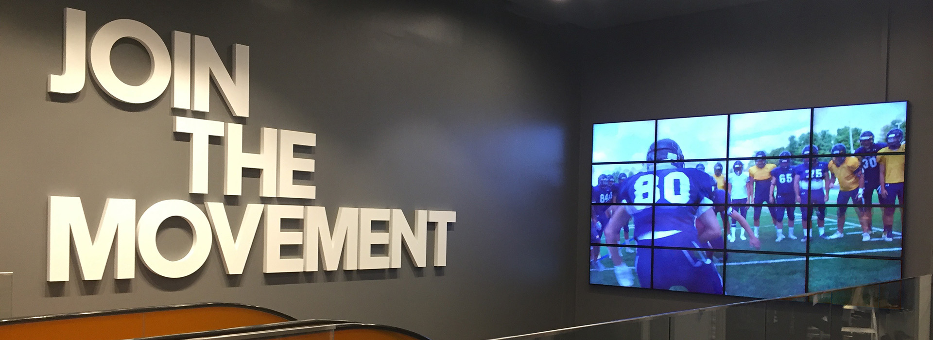 Stadium wall with powerstatement- join the movement